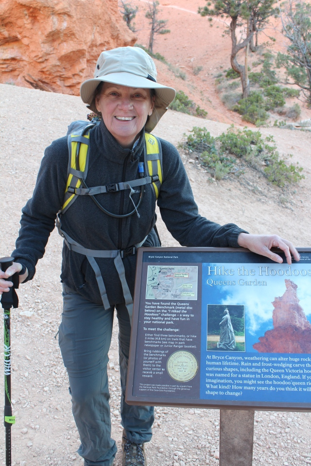 "Jeanne at the Queen's Garden ""Hike the Hoodoos"" trail marker."