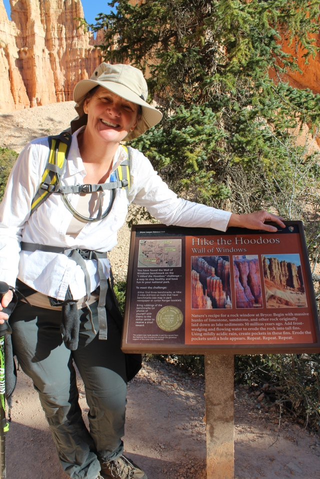 "Jeanne found the ""Hike the Hoodoos"" Wall of Windows trail marker on the Peek-a-Boo Trail."