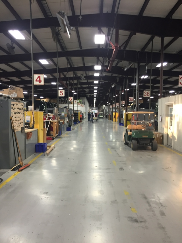 Inside the service center, looking down the aisle of bays.