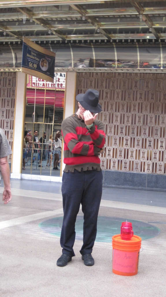 People dress in character all up and down Fremont St. posing for pictures with tourists for tip money.