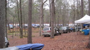 Trade show tents set up in the trees.