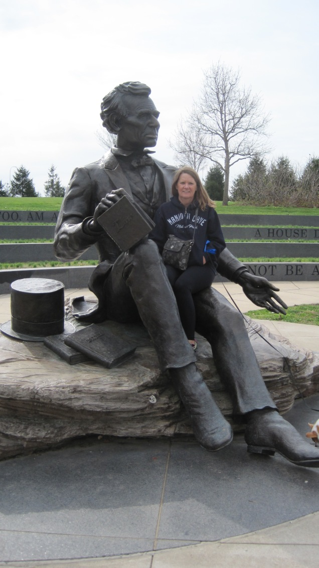 Jeanne getting cozy with ol' Abe.