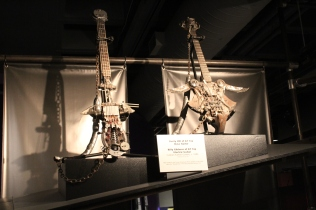 A bass and electric gee-tar used by ZZ Top in one of their music videos.
