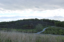 Another view of Little Round Top. The snaky roadway in the lower right sort of splits 2 eventful areas. The little piece to the right is called the Slaughter Pen. The left side of that road below the hilltop is called the Valley of Death. Thousands of men died quickly in both of these geographical locations.