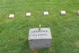 There are several types of grave markers found throughout the cemetery, some with names, some only numbers.