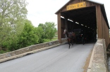 Bitzer's Mill covered bridge. This constitutes an Amish traffic jam of epic proportions...a close look shows 2 Amish horse/wagon combos in bumper-to-bumper formation.