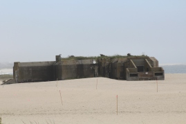 This is a WWII gun emplacement bunker, still standing but unarmed. At least our enemies hope so...