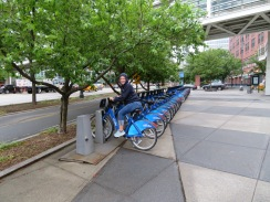 Jeanne testing the fit of the City Bikes. They had bikes and racks scattered all over the city.