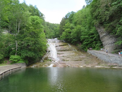 Buttermilk Falls with a large swimming pool at the base.