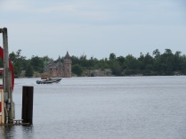 Looking out across St. Lawrence River from the east docks of A-Bay. The Power House for Boldt Castle is in full view on Heart Island.