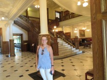 The grand entryway staircase, behind the hot babe...