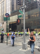 Jeanne playing tour guide at Trump Tower with the pro-Israel parade going by.
