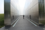 """At Liberty Park they have erected the Empty Sky Memorial to Jersey folks who lost their lives on 911. The parallel walls create a hallway aimed at the """"hole in the sky"""" that previously contained the Twin Towers."""