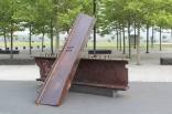 These parts from the Twin Towers lay at the front of the Empty Sky Memorial.