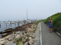 Jeanne taking a walk along the waterline in Stonington.