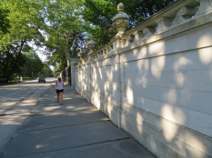 Walking along the fence of the Marble House.