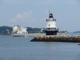 Spring Point Ledge Light stands guard as a big ol' cargo ship passes by...