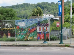 A little fence art in downtown, looks like plastic bags were the medium.