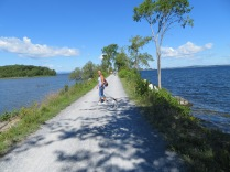 Surrounded by water, the trail is heavily used by bicycles, joggers, and walkers.