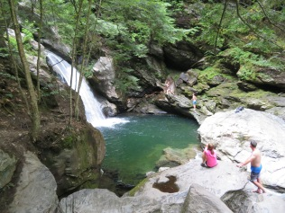 The popular swimming hole at Bingham Falls, complete with rock jumpers.