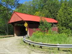 Let me guess what this covered bridge may be named...uh...would it be the Red Covered Bridge?!