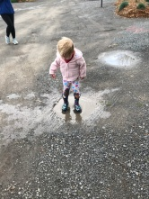 Of course, little Miss Hailey knows how to find the mud puddles after a rain...